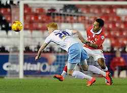 Bristol City's Korey Smith challenges Coventry City's Ryan Haynes - Photo mandatory by-line: Dougie Allward/JMP - Mobile: 07966 386802 - 10/12/2014 - SPORT - Football - Bristol - Ashton Gate Stadium - Bristol City v Coventry City - Johnstone's Paint Trophy