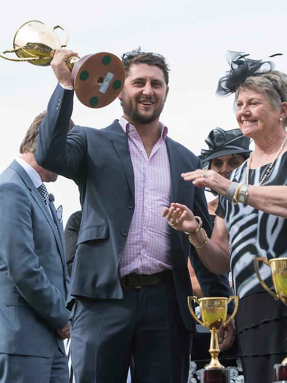 Part trainer Harry Bull celebrates Mungo Jerry winning the Christchurch Casino 151st New Zealand Cup, Riccarton Racecourse, Christchurch, New Zealand, Saturday, 15 November, 2014.  <br /> Credit:SNPA / David Alexander