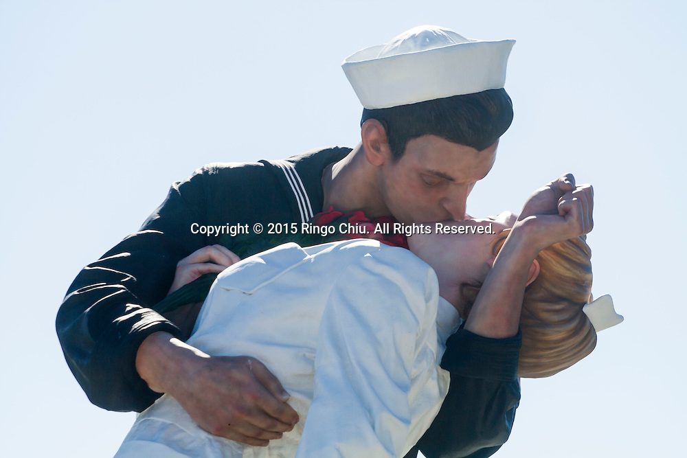 A sculpture by artist Seward Johnson entitled 'Unconditional Surrender' is on display in Tuna Harbor across from the USS Midway aircraft carrier museum in San Diego, California.(Photo by Ringo Chiu/PHOTOFORMULA.com)