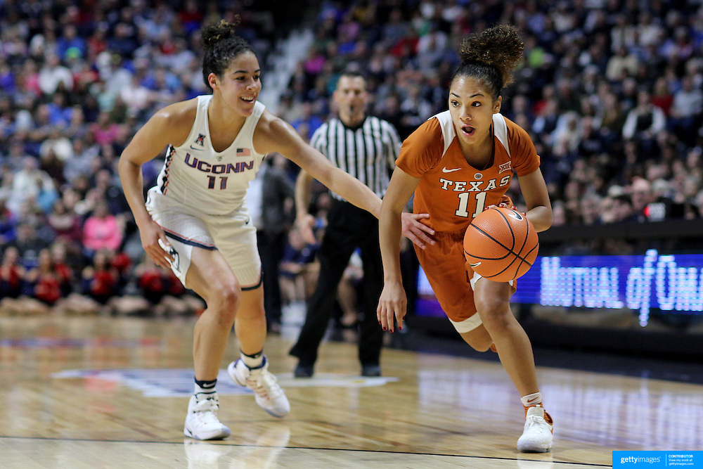 UNCASVILLE, CONNECTICUT- DECEMBER 4: Brooke McCarty #11 of the Texas Longhorns idrives to the basket defended by Kia Nurse #11 of the Connecticut Huskies during the UConn Huskies Vs Texas Longhorns, NCAA Women's Basketball game in the Jimmy V Classic on December 4th, 2016 at the Mohegan Sun Arena, Uncasville, Connecticut. (Photo by Tim Clayton/Corbis via Getty Images)