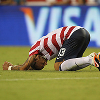 United States Midfielder Jermaine Jones (13) lies in pain during an international friendly soccer match between Scotland and the United States at EverBank Field on Saturday, May 26, 2012 in Jacksonville, Florida.  The United States won the match 5-1 in front of 44,000 fans. (AP Photo/Alex Menendez)