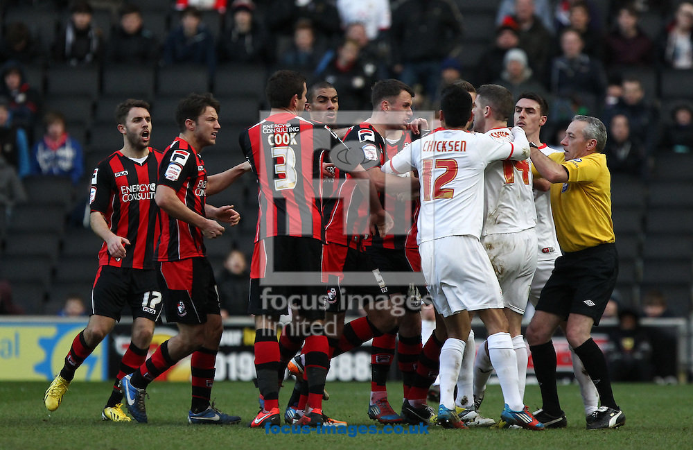 Picture by John  Rainford/Focus Images Ltd +44 7506 538356.02/02/2013.Ryan Lowe of Milton Keynes Dons is surrounded by Bournemouth players after his two-footed lunge as referee Mathieson attempts to get him from the pitchduring the npower League 1 match at stadium:mk, Milton Keynes.
