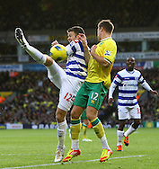 Picture by Paul Chesterton/Focus Images Ltd.  07904 640267.26/11/11.Anthony Pilkington of Norwich and Jamie Mackie in action during the Barclays Premier League match at Carrow Road Stadium, Norwich.