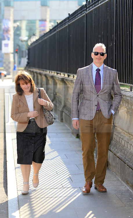 "© Licensed to London News Pictures. 9/05/2016. Belfast, Northern Ireland, UK. Karen and Colin McArthur (parents of Daniel McArthur) arrive at Belfast High Court for the start of an appeal hearing over gay marriage cake row with Ashers Baking Company. The legal appeal by Ashers Baking Company in the controversial 'gay cake' case is to be heard over two days. In May last year a judge at Belfast County Court ruled that the bakery had acted unlawfully. The court ordered Ashers to pay £500 damages after Judge Isobel Brownlie said the customer had been treated ""less favourably"" contrary to the law and the bakery had breached political and sexual orientation discrimination regulations. But the McArthur family who own and run Ashers decided to challenge the ruling following consultations with their legal advisors. The family has been given the full support of The Christian Institute, which has funded their defence costs. The legal case followed a decision in May 2014 by Ashers to decline an order placed at its Belfast store by a gay rights activist who asked for a cake featuring the Sesame Street puppets, Bert and Ernie, and the campaign slogan, 'Support Gay Marriage'. The customer also wanted the cake to feature the logo of a Belfast-based campaign group QueerSpace. Ashers, owned by Colin and Karen McArthur, refused to make the cake because it carried a message contrary to the family's firmly-held Christian beliefs. They were supported by their son Daniel, the General Manager of the company. But the Equality Commission for Northern Ireland (ECNI) launched a civil action against the family-run bakery, claiming its actions violated equality laws in Northern Ireland and alleging discrimination under two anti-discrimination statutes – The Equality Act (Sexual Orientation) Regulations (NI) 2006 and The Fair Employment and Treatment (NI) Order 1998. Photo credit : Paul McErlane/LNP"