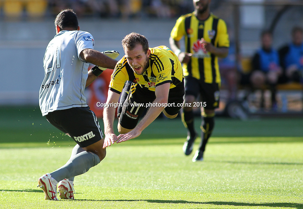 Phoenix' Jeremy Brockie is brought down in the box & awarded a penalty  during the A-League football match between the Wellington Phoenix & Brisbane Roar at Westpac Stadium, Wellington. 4th January 2015. Photo.: Grant Down / www.photosport.co.nz