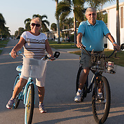 Lorraine and John Gomes, retirees from Lowell, Massachusetts, who live part-time at the Naples Land Yacht Harbor community in Naples, Florida are photographed in a portrait on their bikes outside the mobile home they own on the property on March 21, 2015. <br /> <br /> photos by Angela Jimenez for Thomson Reuters/IALC