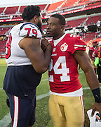 San Francisco 49ers running back Shaun Draughn (24) and Houston Texans offensive guard Jeff Allen (79) talk after a preseason game at Levi's Stadium in Santa Clara, Calif., on August 14, 2016. (Stan Olszewski/Special to S.F. Examiner)