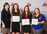 Angel Riggs presents Alayna Jackson, DaLacy Dockrey,Logan McGhee, the Shawnee Milling Company Endowed Scholarship