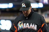 Manager Mike Redmond #11 of the Miami Marlins walks off the field after discussing a call at 1st base in Game 2 of a split doubleheader against the Minnesota Twins on April 23, 2013 at Target Field in Minneapolis, Minnesota.  The Marlins defeated the Twins 8 to 5.  Photo: Ben Krause