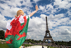 PARIS, FRANCE - Saturday, June 25, 2016: A Wales supporter by the Eiffel Tower, Paris, ahead of the match against Northern Ireland during the Round of 16 UEFA Euro 2016 Championship at the Parc des Princes. (Pic by Paul Greenwood/Propaganda)