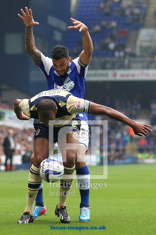 Picture by Richard Calver/Focus Images Ltd +447792 981244<br /> 24/08/2013<br /> Carlos Edwards of Ipswich Town and of Rodolph Austin of Leeds United during the Sky Bet Championship match at Portman Road, Ipswich.