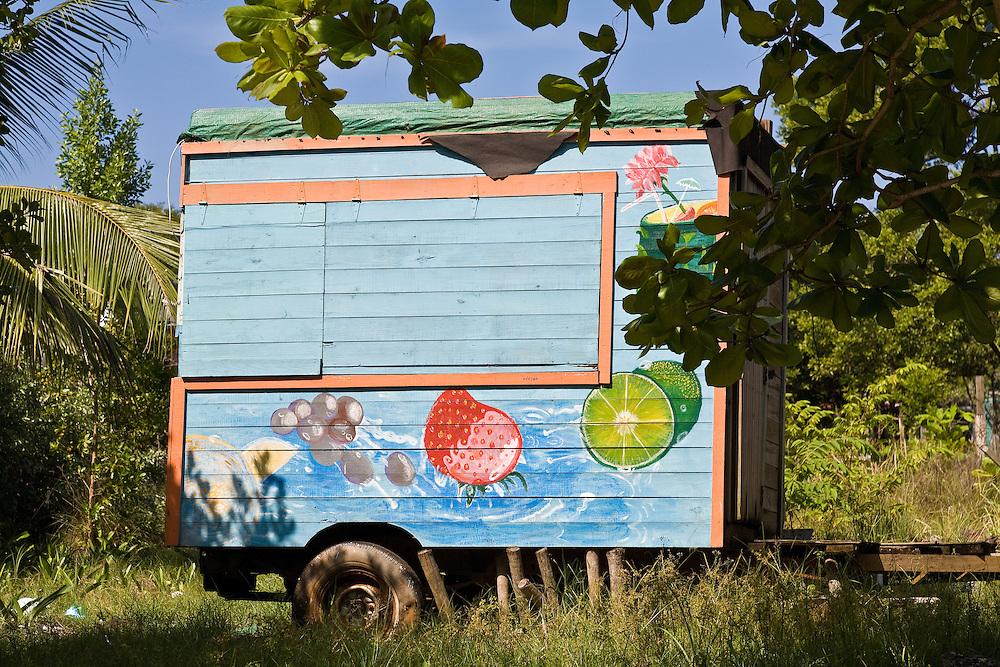 idle food cart in vacant lot in Utila Honduras