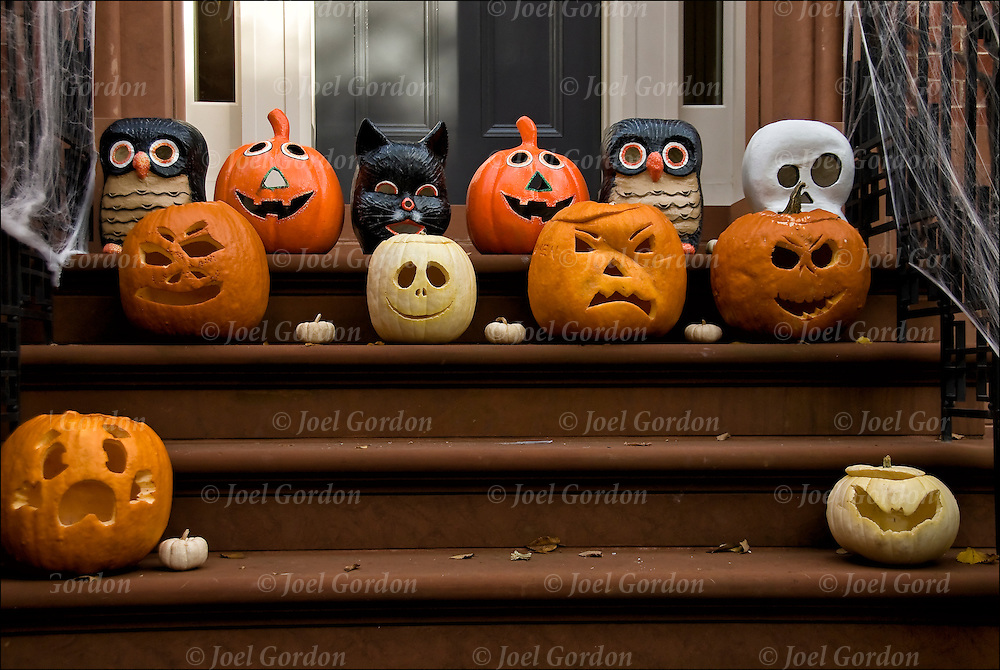 Halloween Decorations in Greenwich Village. Carved pumpkins on door steps made into Jack-0'-Lantrens and other decorations.