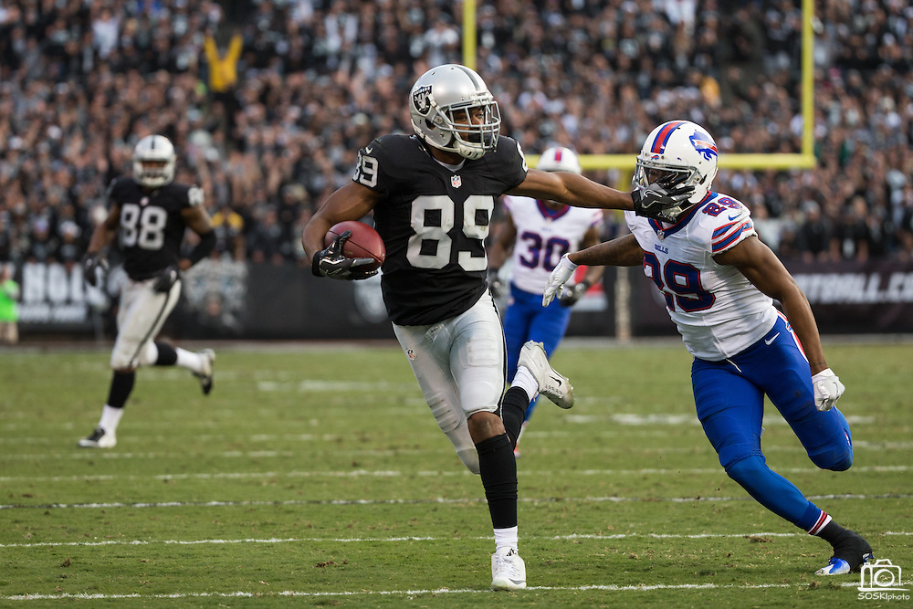 Oakland Raiders wide receiver Amari Cooper (89) stiff arms Buffalo Bills cornerback Kevon Seymour (29) during a carry at Oakland Coliseum in Oakland, Calif., on December 4, 2016. (Stan Olszewski/Special to S.F. Examiner)