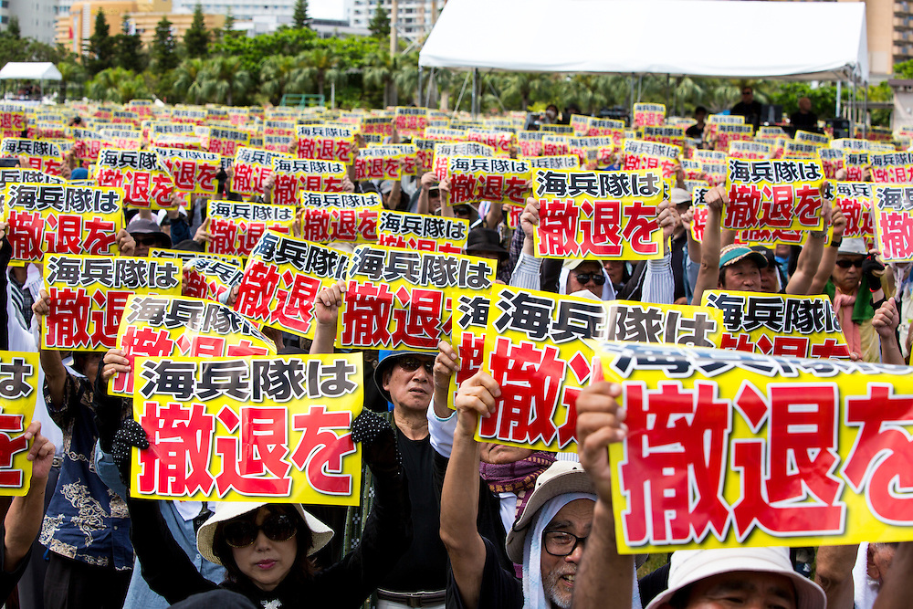 OKINAWA, JAPAN - JUNE 19 : Thousands of people raised their placard gather to oppose the U.S. Airbase relocation to Henoko at Ohnoyama General Athletic Field at the Ohnoyoma Park and sports complex in central Naha, Okinawa on June 19, 2016. A prefectural rally which attended by 65,000 people all over Japan. <br />  Photo: Richard Atrero de Guzman