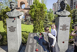 April 26, 2018 - Kiev, Kiev, Ukraine - Children put flowers in a  memorial during the celebrations in Kiev of the 32nd anniversary of the Chernobyl  nuclear accident, Ukraine. (Credit Image: © Celestino Arce/NurPhoto via ZUMA Press)