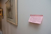 "March 6, 2015, Paris, France. Post-it notes decorate the Paris' apartment where Georges and Maryse Wolinski used to live. French Cartoonist Georges Wolinski (1934 –2015) wrote daily post-it notes to his wife Maryse Wolinski (1943, Algiers). Two month after the death of Georges Wolinski, the apartment is full of souvenirs and notes, attesting a half-century-long love relation: ""9.40 pm. I bought your books. I gave my drawing to Cabu. Veronique was already alseep. I ate in a Chinese restaurant. I think about you, and your fatigue and your courage. I love you, Georges."" <br /> The cartoonist Georges Wolinski was 80 years old when he was murdered by the French jihadists Chérif en Saïd Kouachi, he was one of the 12  victims of the massacre in the Charlie Hebdo offices on January 7, 2015 in Paris. Charlie Hebdo published caricatures of Mohammed, considered blasphemous by some Muslims. During his life, Georges Wolinski defended freedom, secularism and humour and was one of the major political cartoonists in France. The couple was married and had lived for 47 years together. Photo: Steven Wassenaar."