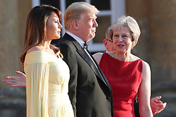 © Licensed to London News Pictures . 12/07/2018. Blenheim, UK. US President Donald Trump and his wife Melania meet British Prime Minister Theresa May and her husband Philip at Blenheim Palace , ahead of a black tie dinner , on the first day of a visit by the American President to the UK . Photo credit: Joel Goodman/LNP