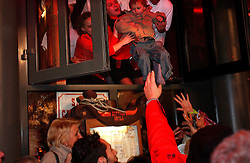 LILLE, FRANCE - DEC-6-2003 - Employees at the Buffalo Grill Restaurant help rescue two children and their mother who were caught in the surging crowd during the opening celebrations for the Lille 2004 European Cultural Capital of Europe inauguration. Event organizers estimated 500,000 people attended the festival. (PHOTO © JOCK FISTICK)