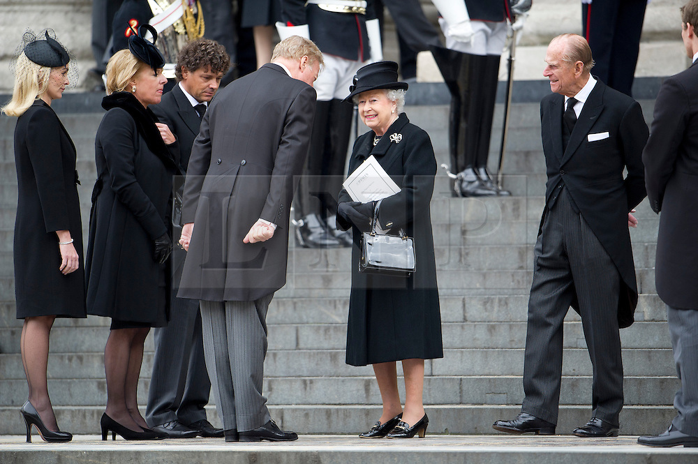 © London News Pictures.17/04/2013. London, UK.  HRH Queen Elizabeth II and Price Philip being greeted by Mark Thatcher, son of Margaret Thatcher and his family as they leave St Paul's Cathedral in London following the funeral of former British Prime Minister Margaret Thatcher on April 17, 2013. Photo credit : Ben Cawthra/LNP