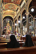 Nuns inside La Basilica church; Cartago, Costa Rica.<br />
