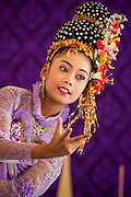 19 APRIl 2014 - BANGKOK, THAILAND:   A girl performs a traditional Thai dance during a performance at the Rattanakosin Festival in Bangkok. Rattanakosin is the name of the man made island that is the heart of the old city. Bangkok was formally founded as the capital of Siam (now Thailand) on 21 April 1782 by King Rama I, founder of the Chakri Dynasty. Bhumibol Adulyadej, the current King of Thailand, is Rama IX, the ninth King of the Chakri Dynasty. The Thai Ministry of Culture organized the Rattanakosin Festival on Sanam Luang, the royal parade ground in the heart of the old part of Bangkok, to celebrate the city's 232nd anniversary.   PHOTO BY JACK KURTZ