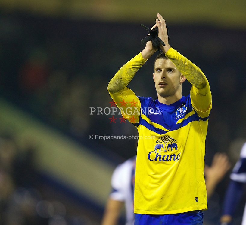 WEST BROMWICH, ENGLAND - Monday, January 20, 2014: Everton's Kevin Mirallas applauds the travelling supporters after his side's 1-1 draw with West Bromwich Albion during the Premiership match at the Hawthorns. (Pic by David Rawcliffe/Propaganda)