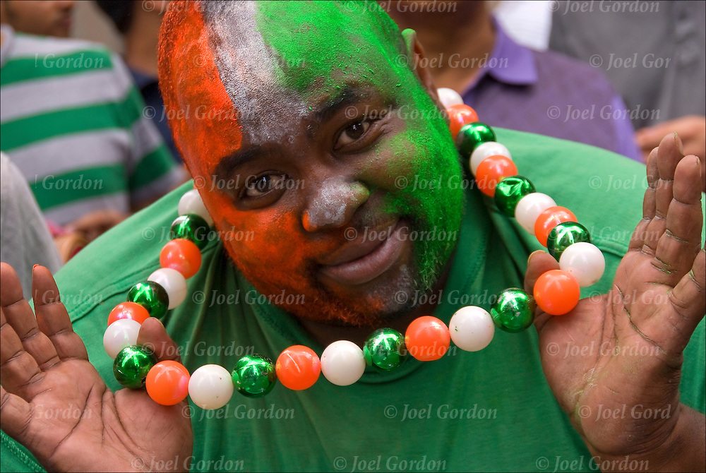 India Independence Day Parade in NYC.  East Indian American in the crowds with face painted the colors of the India flag showing his ethnic pride
