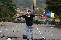 National Guard and anti-chavez protestors clash as a Pro-Chavez march denouncing a recall referendum against chavez and US intervention in Venezuela.  Protestors fired molotov cocktails , rock and bottles at the Guard who responded with tear gas and rubber bullets.