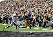 September 24, 2011: Iowa Hawkeyes wide receiver Marvin McNutt (7) pulls in a 13 yard touchdown reception as Louisiana Monroe Warhawks cornerback Vincent Eddie (27) defends during the first quarter of the game between the Iowa Hawkeyes and the Louisiana Monroe Warhawks at Kinnick Stadium in Iowa City, Iowa on Saturday, September 24, 2011. Iowa defeated Louisiana Monroe 45-17.
