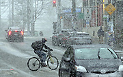 Bicyclists have to be even more careful in the snow, here crossing Pine Street on Capitol Hill on Wed Jan 15, 2020. (Alan Berner / The Seattle Times)