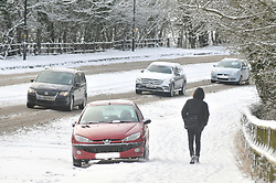 Licensed to London News Pictures 28/01/2018<br /> A pedestrian walks past an abandoned car on the A61 Leeds Road just south of Harrogate, North Yorkshire<br /> Photo Credit: Sam Atkins/LNP