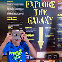 Cole Lopez, 7, looks at a reel of rocket ships through a Viewmaster on the Wonders on Wheels mobile museum, Tuesday June 25 in Gallup. The mobile museum's current exhibit is from the New Mexico Museum of Space History in Alamogordo and will be at the Aztec Library Thursday and at the Farmington Library Friday.