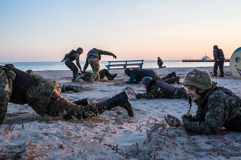 New recruits of the St. Mary's Battalion undergo training on the beach at their base on the Sea of Azov on February 4, 2015 in Mariupol, Ukraine. The pro-Ukraine battalion is one of a few tasked with defending the port city, which was hit late last month by an artillery barrage that killed at least 30 people, from pro-Russia rebels.