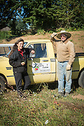 Portrait of farmers Shari Sirkin and Bryan Dickerson by their farm truck.