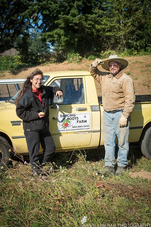 Portrait of farmers Shari Sirkin and Bryan Dickerson by their farm truck.