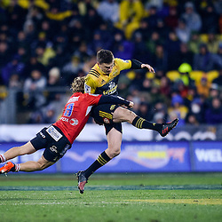 Faf de Klerk of the Lions tackles Beauden Barrett of the Hurricanes during the Super Rugby Final between The Hurricanes and The Lions at Westpac Stadium, Wellington, New Zealand on Saturday, 6 August 2016. Photo: Marco Keller / lintottphoto.co.nz