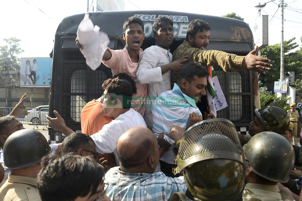 October 6, 2018 - Kolkata, West bengal, India - Police detain Congress members during the protest agitation against VHP in front of National Library.  Congress member takes part in a demonstration to protest against Vishva Hindu Parisad or VHP and Bharatiya janta Party or BJP in front of National Library where VHP President Vishnu Sadashiv Kokje participate in a VHP organized conference. (Credit Image: © Saikat Paul/Pacific Press via ZUMA Wire)