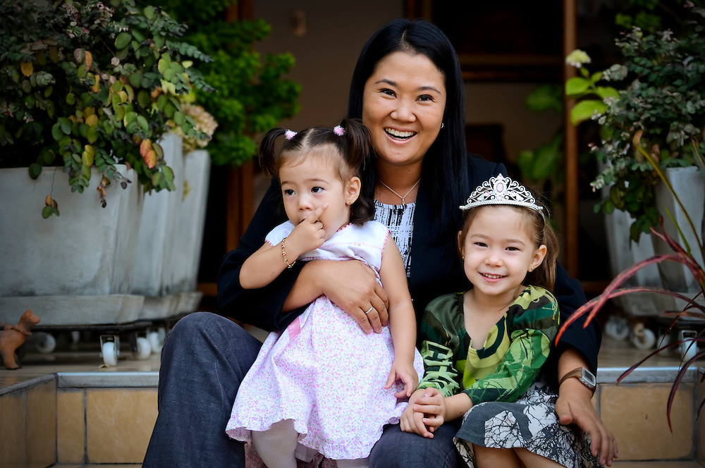 Keiko Fujimori, 35, poses for a portrait with her daughters Kyara Sofía and Kaori Marcela, at their home in Lima, Peru.