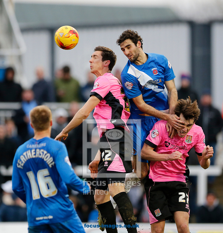 Adam Jackson (2nd r) of Hartlepool United wins a header during the Sky Bet League 2 match at Victoria Park, Hartlepool<br /> Picture by Simon Moore/Focus Images Ltd 07807 671782<br /> 27/02/2016