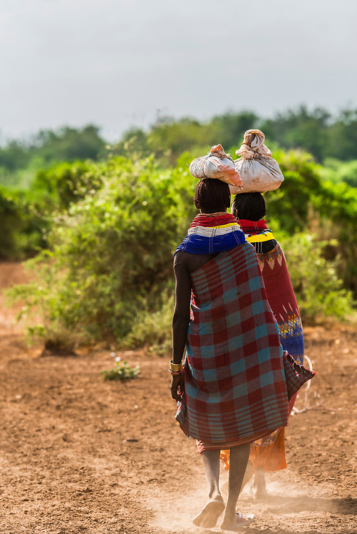 Nyangatom tribe women walking, Omo Valley, Ethiopia.