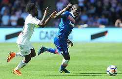 Nathan Dyer of Swansea City applies pressure on Papa Alioune Ndiaye of Stoke City - Mandatory by-line: Nizaam Jones/JMP- 13/05/2018 - FOOTBALL - Liberty Stadium - Swansea, Wales - Swansea City v Stoke City - Premier League