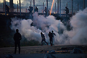 CALAIS, FRANCE - OCT 22: Clashes break out between French riot police and refugees staying at the Calais refugee camp known as the Jungle ahead of the planned eviction of the camp in October 2016.