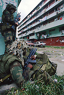 US soldiers takes position to secure a neighborhood from hold out Panamanian army troops loyal to General Manuel Noriega during the US invasion of Panama, December 1989.