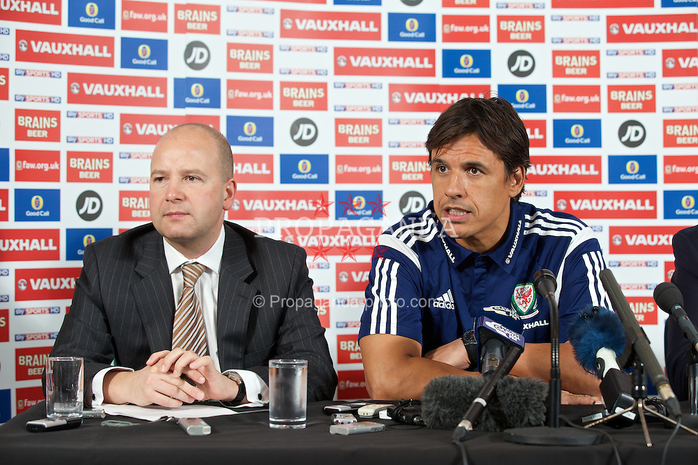 CARDIFF, WALES - Friday, November 15, 2013: Wales' Chief-Executive Jonathan Ford and manager Chris Coleman during a press conference to announce an extension to the manager's contract ahead of the International Friendly match against Finland. (Pic by David Rawcliffe/Propaganda)