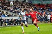 Joe Dodoo of Bolton Wanderers and Alex Gilbey of MK Dons compete for the ball during the EFL Sky Bet League 1 match between Bolton Wanderers and Milton Keynes Dons at the University of  Bolton Stadium, Bolton, England on 16 November 2019.