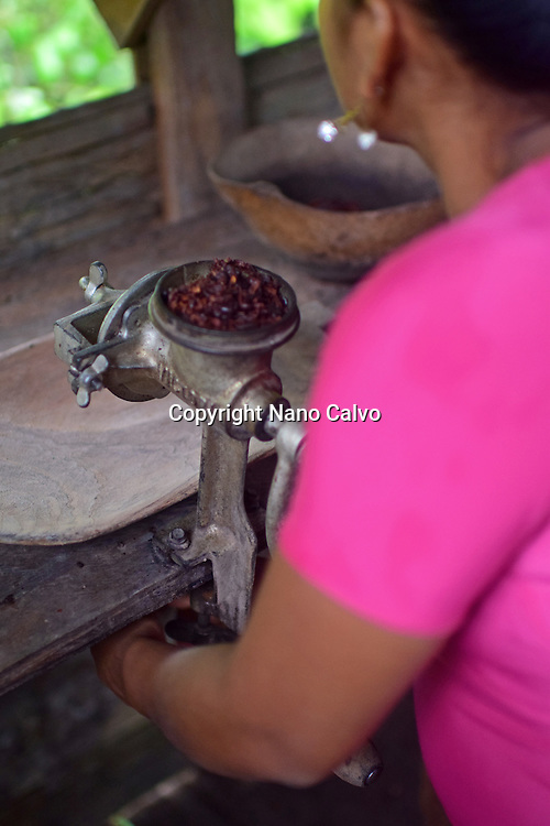 Kathiana helps prepare natural cacao drink at Bribri tribe house. <br />