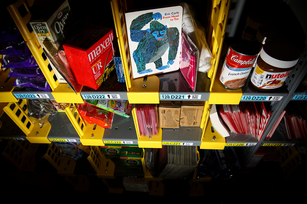 "A variety of items including cassette tapes, the Eric Carle children's book featuring a gorilla ""From Head to Toe,"" Campbell's french onion soup, Nutella, rest on shelves before they are ordered, picked, and delivered at the Amazon.com Inc. Prime Now fulfillment center warehouse on Monday, March 27, 2017 in Los Angeles, Calif. The warehouse can fulfill one and two hour delivery to customers. Complex supply chains such as Amazon's and e-commerce trends will impact city infrastructure and how things move through cities. © 2017 Patrick T. Fallon"