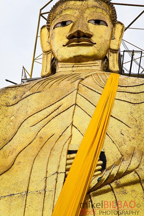 The standing Buddha in Wat Intharawihan..Bangkok, Thailand.