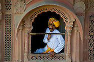 A guard wearing a colourful turban at the Meherangarth Fort in Jodhpur, Rajasthan, India